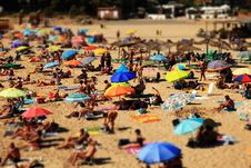 Free View Of Umbrellas And People On A Crowded Beach Royalty Free Stock Images - 83063609