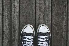 Free Black And White Sneakers On Grey Wooden Wood Stock Photo - 83063640