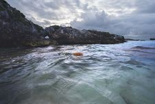 Free Rocky Cliff Near Calm Sea Under Gray Cloudy Sky Stock Photography - 83063652