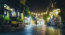 Free Person Standing On Gray Path Way Near Bicycles During Night Time Royalty Free Stock Photography - 83063667