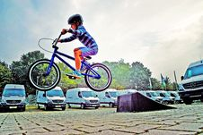 Free Boy In Black Nutshell Helmet On Blue Bmx Bike Having Hangtime After Taking Off On Ramp Stock Photography - 83063692
