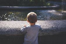 Free Boy In Gray Top Standing In Front Of Water Fountain Royalty Free Stock Image - 83063756
