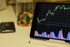 Free White Android Tablet Turned On Displaying A Graph Royalty Free Stock Image - 83063916
