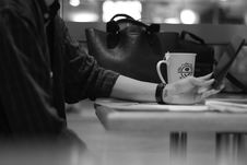 Free Gray Scale Photograph Of Person Sitting Beside Black Leather Bag Stock Photo - 83064020