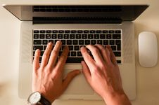 Free Person Typing On Laptop Computer Stock Photos - 83064043