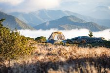 Free Teal And Yellow Dome Tent On Peach Leveled With Clouds Near Mountain Under Daytime Royalty Free Stock Photos - 83064068