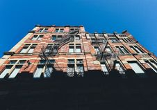 Free Brown Brick Building Wall Under Blue Sky At Day Time Royalty Free Stock Image - 83064086