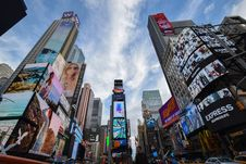 Free Worm S Eye View Of Times Square Under Blue And White Sunny Cloudy Sky Royalty Free Stock Images - 83064299