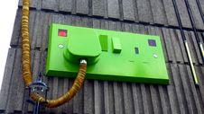 Free Green Rectangular Corded Machine On Grey Wall During Daytime Stock Image - 83064581