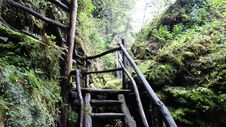 Free Black Wood Stairs Going To Waterfall During Daytime Royalty Free Stock Photos - 83064698