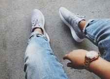 Free Grey Adidas Sneakers Near Blue Denim Bottoms Stock Photography - 83064742