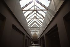 Free Building Hallway With Sunlight Piercing Through Roof Royalty Free Stock Photos - 83064898