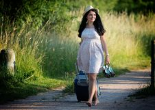 Free Woman Walking While Carrying Shoes And Luggage Bag During Daytime Royalty Free Stock Photos - 83064938