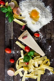 Free Pasta Tomatoes And Flour With Egg Shells On Table Stock Photography - 83064982