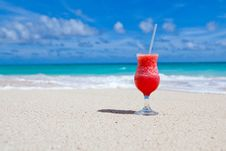 Free Red Slush Drink In Glass On Beach Royalty Free Stock Photography - 83065317