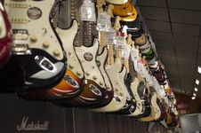 Free Electric Guitar Hanging Near Wall Stock Photo - 83065330