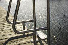 Free Ladder On Wooden Dock By Sea Stock Images - 83065584