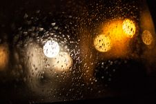 Free Raindrops And Light Reflecting On Window Royalty Free Stock Photos - 83065588