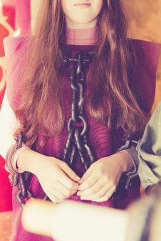 Free Woman In Maroon Shirt With Black Chain On Her Body Royalty Free Stock Images - 83065639