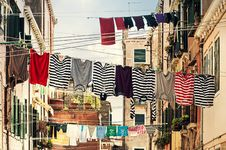 Free Striped Shirt Hanging On Gray Wire Between Beige Painted Wall Building During Daytime Stock Photo - 83065660