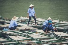 Free Man Riding On Green Rowboat During Daytime Royalty Free Stock Photo - 83065685