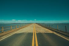 Free Grey Concrete Road In The Middle Of The Sea Royalty Free Stock Image - 83065736