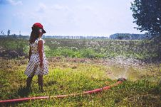 Free Girl On Green Grass Near Red Hose While Pumping Water During Daytime Royalty Free Stock Photo - 83065795