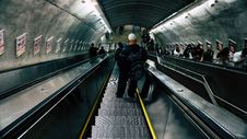 Free Man In Black Leather Jacket On Escalator Royalty Free Stock Photography - 83065937