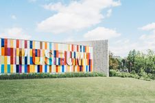 Free White Red And Blue Museum On Green Grass Royalty Free Stock Photography - 83066087