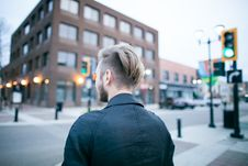 Free Man Wearing Black Shirt Standing On City Street During Daytime Stock Images - 83066154