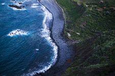 Free Areal Photo Of A Sea Waves Splashing On Sea Sand Beside Mountain Royalty Free Stock Photo - 83066215