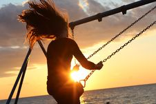 Free Woman On Swing During Sun Set Royalty Free Stock Photos - 83066288