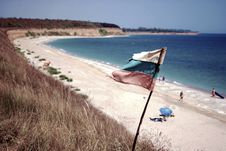 Free Blue Ocean Near On White Sands With White Blue And Red Flag On Shore Stock Photos - 83066353
