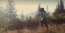 Free Backpacker In Countryside Royalty Free Stock Photos - 83066398