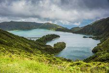 Free Blue Lake Behind Green Mountain Under White Clouds Stock Image - 83066471
