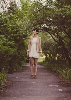 Free Woman In Beige Blazer Standing On Pathway Surrounded By Green Trees During Daytime Royalty Free Stock Photo - 83066545