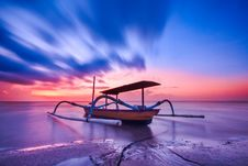 Free Brown Blue And White Wooden Boat During Orange Sunset Royalty Free Stock Images - 83066739