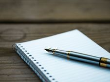 Free Gold And Silver Pen On White Ruled Spiral Notebook Royalty Free Stock Image - 83067566