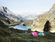 Free Pink And Gray Tents On Green Grass During Daytime Royalty Free Stock Photography - 83067587