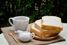 Free 3 Sliced Loafs Beside White Ceramic Coffee Cup Stock Image - 83067991