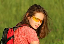 Free Woman In Red Shirt Wearing Backpack Surrounded By Green Grass Field Royalty Free Stock Images - 83068029