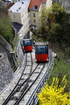 Free Red And Black Cable Train Uphill Near The Houses During Daytime Stock Photos - 83068083