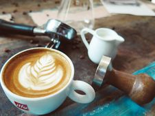 Free Latte On Cup Beside Milk Cup Stock Image - 83068221