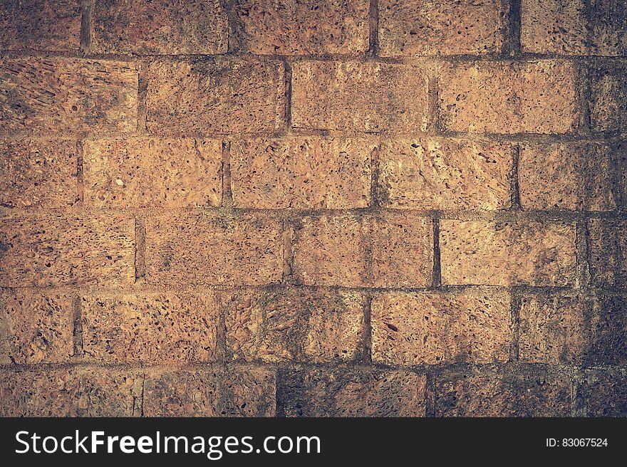 Brown and Black Brick Wall Close Up Shot Photography