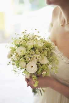 Free Woman In Bridal Gown Holding Bouquet Of White Flowers Stock Images - 83074004