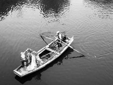 Free Man In White Boat Royalty Free Stock Images - 83074039