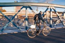 Free Man In Black Jacket Riding Black Bicycle In Gray Concrete Road In Panning Photography Royalty Free Stock Images - 83074089