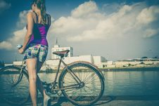 Free Woman In Pink Spaghetti Strap Dress Holding A Brown Road Bicycle During Day Time Royalty Free Stock Photo - 83074115