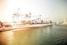 Free White And Orange Cargo Ship Docking During Daytime Royalty Free Stock Photo - 83074175