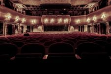 Free Person Sitting In Empty Theater Royalty Free Stock Photos - 83074228